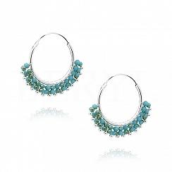 Kolczyki koła srebrne z wiszącymi niebieskimi kryształkami swarovski